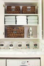 Organize your laundry room using baskets, labels, jars and tiered storage  cupboards