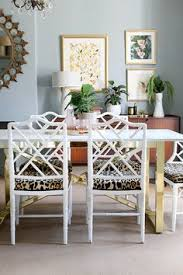 dining room with faux bamboo chairs boho glam