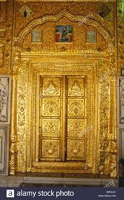 richly painted wall gold plate embossed door and doorframe of gurudwara of sachkhand sahib nanded maharashtra india