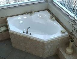 x corner air jetted bathtub with center drain by tub kohler