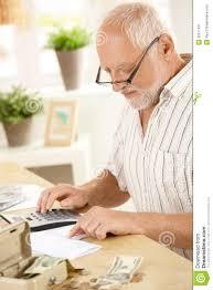 older man using calculator at home royalty stock photography older man using calculator at home