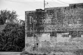 old architectural photography. Contemporary Architectural Black And White Photograph Of A Fading Peeling Ghost Sign Ad On The Side With Old Architectural Photography