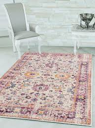 provide a luxurious appeal to your interior design with this chic rug this piece creates a beautiful affect by using shades of light cream magenta pink