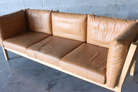tan leather sofa by andreas hansen