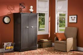 modern office armoire black computer armoire with orange wall and single sofa fl carpet for