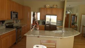 traditional kitchen with cream granite countertops denver white porcelain undermount kitchen sink and side
