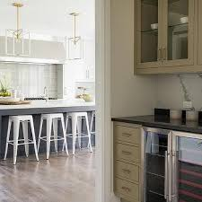taupe cabinets with black granite countertops