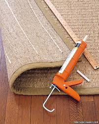 if you re wanting a more diy route martha stewart made adding strips of caulking on the back of an area rug a thing back in 2002