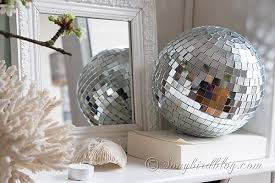 Decorative Disco Ball Mantel Decoration with Cherry Blossoms and a Disco Ball 1