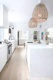 light pendants kitchen all white kitchen with a marble island and rattan pendant lights pendant lights