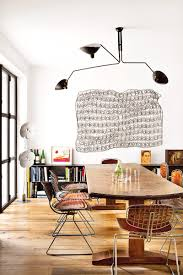rustic dining room art. Great Dining Room With Metal Sculpture As Wall Art And Contemporary Industrial Fixture. #diningroom Rustic