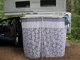 outdoor shower with a four wheel camper
