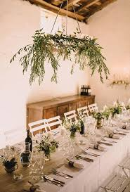 wi olive branches are the perfect match for this low key reception setup we