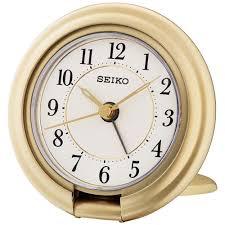 sentinel seiko travel alarm clock with screen press function gold og qht014g