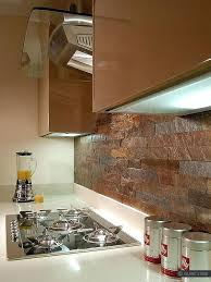modern kitchen with copper color slate backsplash black subway tile
