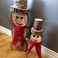 log snowmen decorations for winter