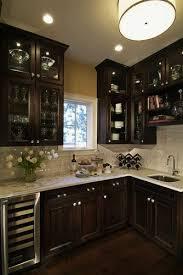 dark oak kitchen cabinets. Traditional Dark Wood Kitchen Design With Glass Cabinetry - Denver Kitchens Oak Cabinets