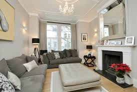 View in gallery White moulding in a taupe living room