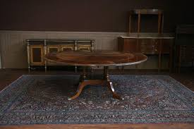 expandable round dining table shown with leaves