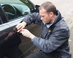 locked car. Emergency Locksmith Helping A Locked Out Of Car Customer