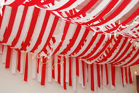 Candy Cane Theme Decorations streamers Plastic table cloth from dollar store One red and one 9