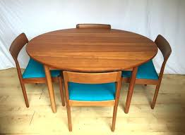 round extended dining table danish teak vintage mid century oval round extending dining table and four chairs contemporary extending dining tables uk