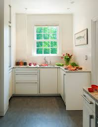 This tiny white corner kitchen is filled with lots of storage and colorful  eclectic decorative pieces. A work island is a clever and unexpected  addition to ...