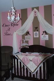 delightful baby girl room with stripped pink wall and white curtain bed decor idea