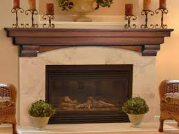 wooden fireplace mantel shelf with wrought iron holders