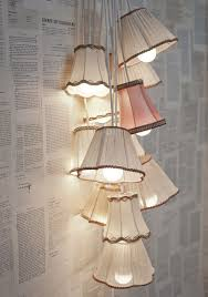 such a cute idea have a few extra lshades laying around transform them into a chic light fixture craft oh i love the book pages used as wall paper
