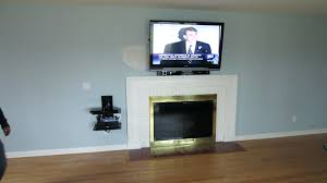 mounting a tv over fireplace install on wall