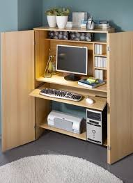 space saver computer desks a home office inside the living room consisting of a desk in