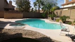 Swimming Pool:Incredible Backyard Pool Landscaping With Neutral Water  Fountain And White Umbrella Great Looking