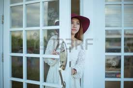 looking out door. Sad Asian Vintage Woman Looking Out The Door Photo E