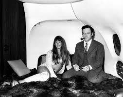 the president of enterprises hugh hefner with girlfriend barbi benton in his