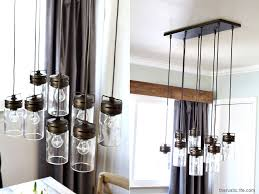 the mason jar chandelier we got from and is made by allen roth the finish we chose was a bronzed look but they also have it in a beautiful silver