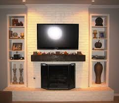 crown molding and interior paint color with painted brick fireplaces also brick fireplace and decorating fireplace mantel with tv over fireplace plus