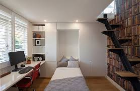 home office with a bed and ample storage space design bayview design group