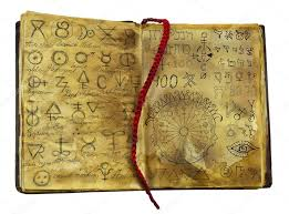 old witch book with alchemic symbols stock photo