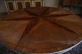 expandable round pedestal dining table. round pedestal dining table with star inlay and expandable perimeter leaves. s