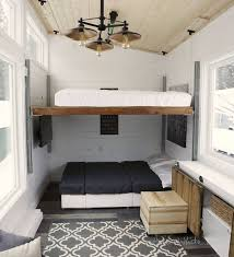 tiny home furniture. other clever tricks here include a builtin console at the center of home covered by sliding doors that can pull up into two desks or one longer tiny furniture e