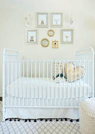 neutral gender nursery features an eclectic art gallery as well as a rh baby child wool felt bunny head and wool felt deer head placed over a white