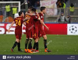 Roma giocatori, da sinistra, Alessandro Florenzi, Stephan El Shaarawy,  Daniele De Rossi e Kevin Strootman celebrare alla fine della UEFA Champions  League round di 16 seconda gamba partita di calcio tra Roma