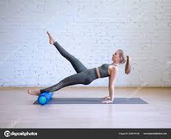 Light Pilates Yoga Studio Caucasian Young Woman In Grey Sports Suit Doing Pilates