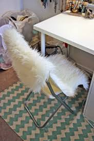 simple interior design with ikea faux sheepskin rug and white green