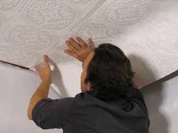 holding wallpaper on ceiling