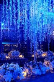 crystals and blue uplighting instantly create a trendy winter wedding ambiance blue wedding uplighting