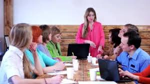 the office the meeting. Woman CEO Praises Personally Employees For Work Performed At The Meeting. Modern Office. Office Meeting