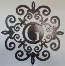 family initial monogram inside a metal scroll with g letter 20 inches wall decor