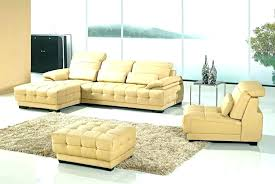 abbyson metropolitan top grain leather sectional and ottoman living tufted round brown sofa ivory silo gliding